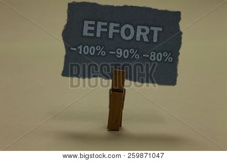 Handwriting text writing Effort 100 90 80. Concept meaning Level of determination discipline motivation Paperclip retain ash color written torn thick page on shadow ash floor. poster
