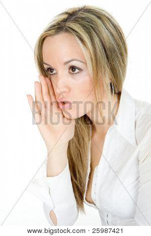 Blond girl whispering  on white background