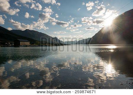 Majestic Mountains At Sunrise Reflected In Beautiful Calm Gjende Lake, Besseggen Ridge, Jotunheimen