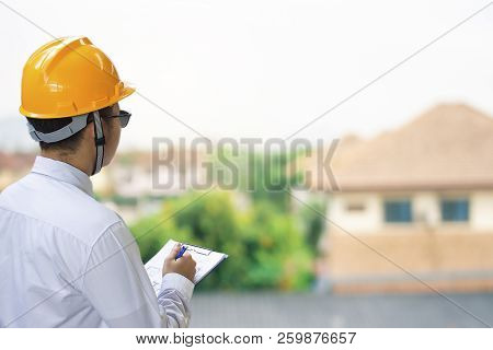 Male Engineer Inspection Checking In Home With Note On Notepad Or Home Blurred Background.metaphor Q
