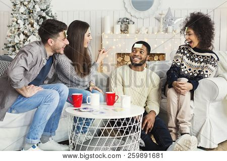 Happy Winter Evening. Four Friends Are Playing Together Who I Am At Home, Copy Space