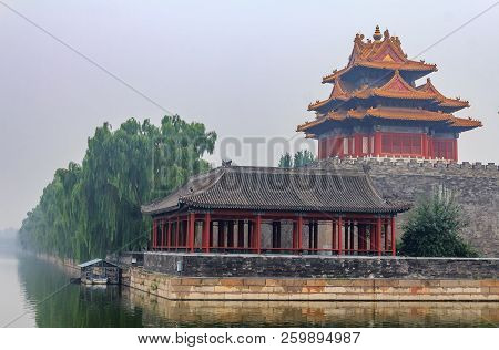 View On East Corner Of Palace Museum At The Forbidden City And The Surrounding Moat Filled With Wate