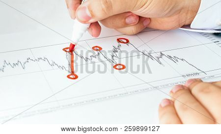 Closeup Photo Of Businessman Analyzing Stocks Sale Rates And Drawing Financial Graph