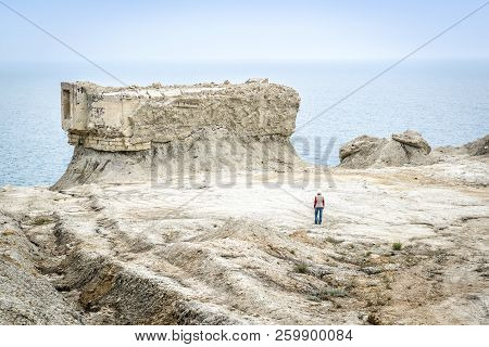 Excavated Fortifications From The Second World War In Feodosia, Crimea, Russia. Traveler Walks Among