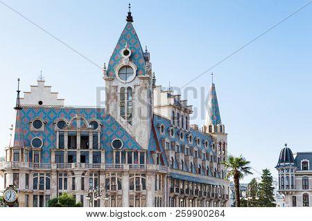 Batumi, Adjara, Georgia - August 21, 2018 Beautiful Building With Blue Roof Tiles And Tower At Europ