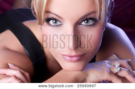 Macro image of a beautiful girl face with blue eyes