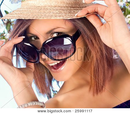 pretty woman with  hat and sunglasses in summer time