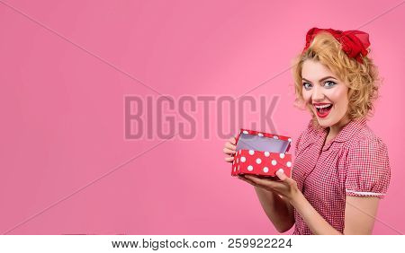 Happy Woman Holds Gift Box. Beautiful Emotional Girl Holds Box. Pin Up Style. Season Sales. Discount