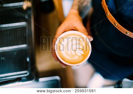 Professional Barista In Coffee Shop Making Fresh Cappuccino And Brewing Coffee