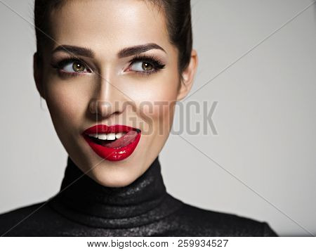 Young woman with bright face expression. Girl's face with a big surprise.