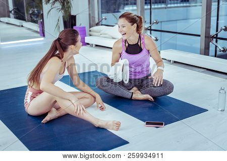 Jovial Mature Woman Blabbing With Yoga Trainer