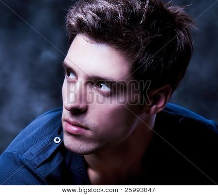 Close up  Shot of a Young Man. A trendy European man dressed in contemporary cloth. He is now a professional model.