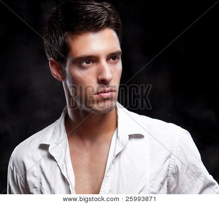 Close up Fashion Shot of a Young Man. A trendy European man dressed in contemporary white shirt. He is now a professional model poster
