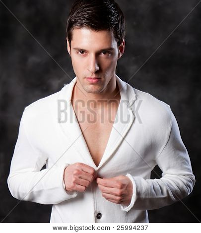 Fashion Shot of a Young Man. A trendy European man dressed in contemporary cloth. He is now a professional model.