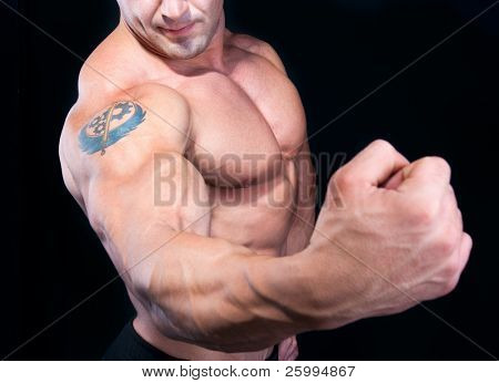 The Perfect male strong hand  isolated on black background