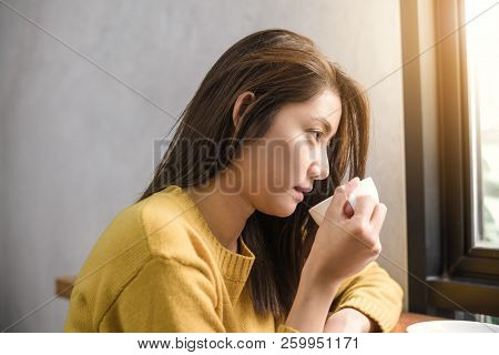 Close Up Of A Young Asian Woman Drinking Coffee In Coffee Shop Holding A Cup Of Coffee In Her Hand S