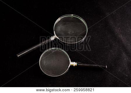 Vintage Magnify Glass Loupe On A Black Background