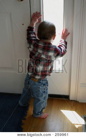 Toddler Looking Out Window 002