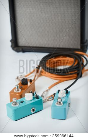 Electric Guitar Stomp Effectors And Cables In Studio. Focus Is On Forehand Switch Box.