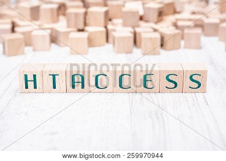 The Word Htaccess Formed By Wooden Blocks On A White Table