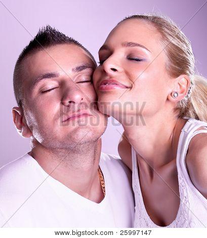 Tender young couple posing, studio shot