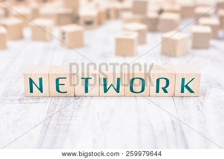 The Word Network Formed By Wooden Blocks On A White Table