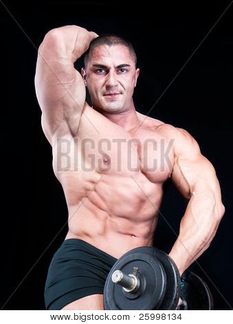 Man  with a bar weights in hands training, isolated on black