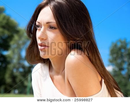 Beautiful glamorous woman with white dress, outdoor shot