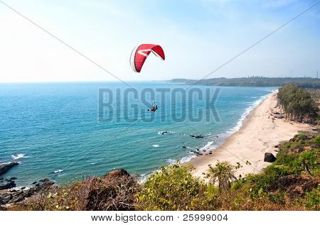 Paraglider and  Beautiful Tropical beach ,Goa, India
