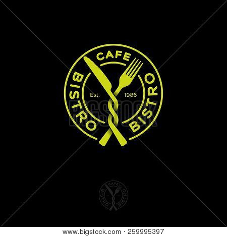 Bistro Restaurant Or Cafe Logo. Snack Emblem. A Fork And A Knife In A Yellow Circle. Fast Food Cafe