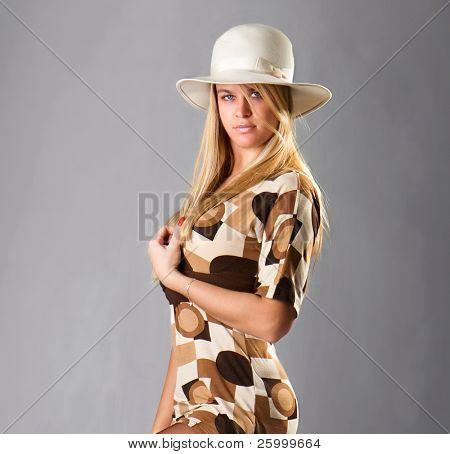 Beautiful fashion woman portrait with white hat,studio shot