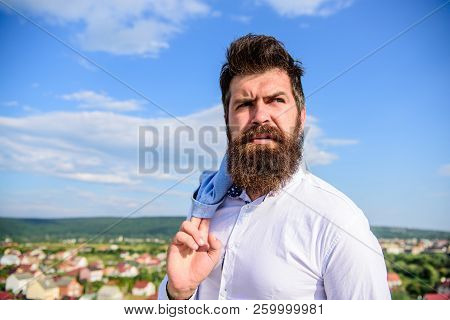 Motivation and ambitions concept. Hipster beard mustache looks puzzled frustrated. Frustration feeling. Man bearded hipster formal style look back sky background. Guy reached top but feel frustrated poster
