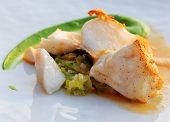 Fried codfish with leek brunoise green vegetable cream and foaming sauce gourmet dish poster