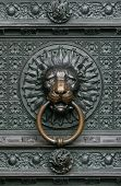 Bronze knocker in the shape of a lion head from the gate of the Cologne Cathedral, Germany poster