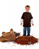 Worried preschooler who's dumped a big bag of dogfood into his pet yorkie's tiny bowl. The dog is peering around the bag. poster
