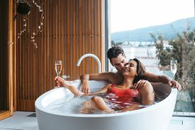 Couple Enjoying A Bath With Champagne