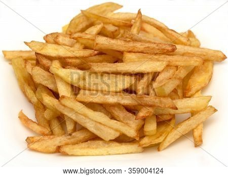 The French Fries Is Ready To Be Eaten. Golden French Fries Cooked In Oil. Tasty But Not Healthy.