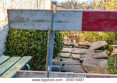 Construction Barrier In Front Yard. Barricade For Construction Site Of Sewerage Shaft. Focus On Back