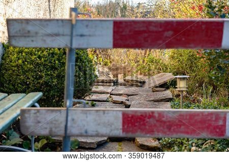 Construction Barrier In Front Yard. Barricade For Construction Site Of Sewerage Shaft. Bench