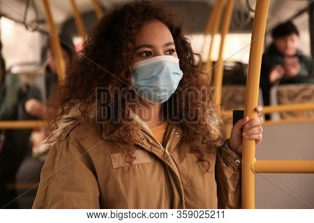 African-american Woman With Disposable Mask On Bus. Virus Protection