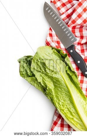 Fresh green Romaine Lettuce, knife and checkered napkin. Leaves of Lactuca sativa isolated on white background.