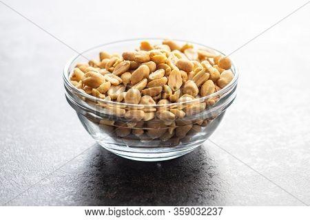 Roasted salted peanuts. Crispy nuts in bowl.