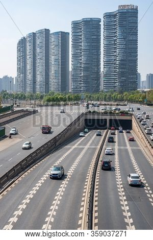 Chengdu, Sichuan Province, China - March 31, 2020 : Highway Traffic With Skyscrapers In The Backgrou