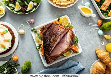 Big Traditional Easter Brunch With Salmon, Quiche Lorraine And Carrot Cake And Ham In The Middle