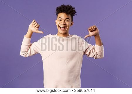 Portrait Of Confident Young Upbeat Man, Smiling Bragging, Being Boastful About Own Accomplishments,