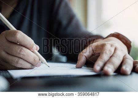 Hands Student Testing In Exam On Exercise Sheet, Taking At School Or University In Test Room, Writin