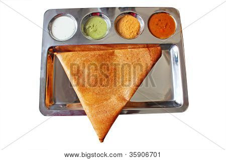 Appetizing and delicious traingular Indian masala dosa in golden brown color with 3 types of chutney and sambhar served in a steel plate. This thin masala dosa is more popular in chennai and tamilnadu poster