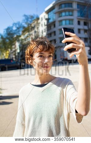 Beautiful Young Woman Taking Selfie With Smartphone. Cheerful Young Lady Posing For Self Portrait On