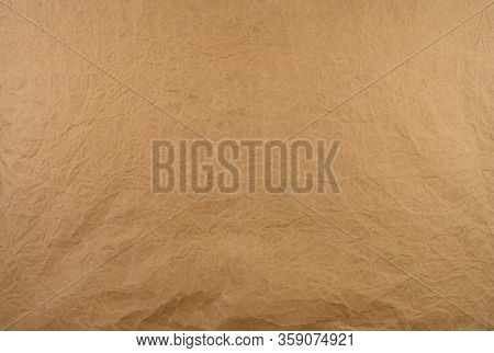 Old Wrinkled Brown Paper Texture Background. Rough Brown Kraft Paper Texture. Recycle Cardboard Shee