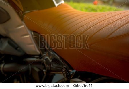 Motorcycle Seat. Brown Leather Vintage And Classic Style Motorcycle Seat. Closeup Motorbike Seat Par